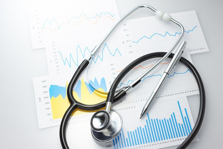 a stethoscopes and some medical charts