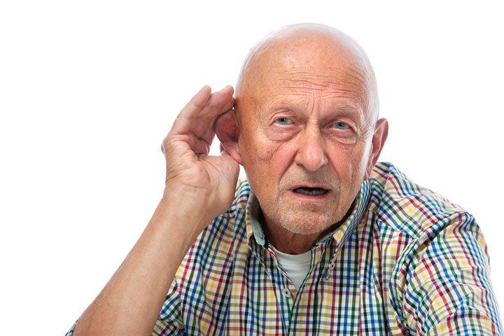 Senior man cupping his ear