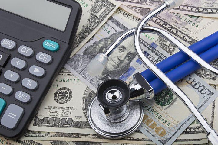 USD notes, stethoscope, calculator